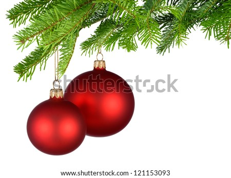 Bright studio shot of two isolated red Christmas baubles hanging from fresh green fir twigs - stock photo