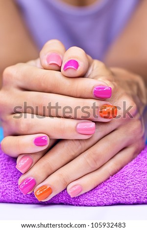 Bright stylish manicure with colored nail polish - stock photo