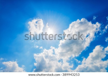 Bright sun in blue sky. - stock photo