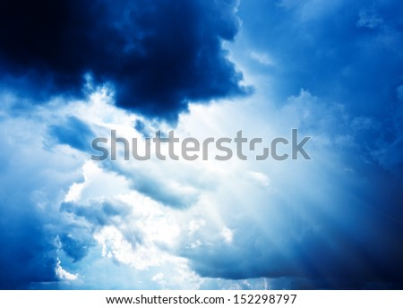 Bright sun in blue sky with clouds  - stock photo