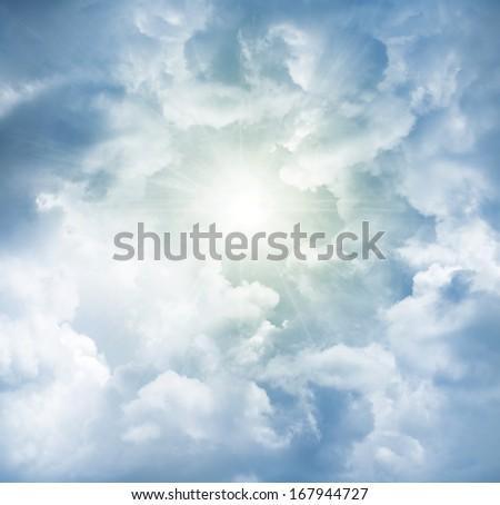 Bright sun in cloudy sky - stock photo