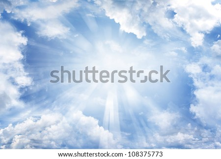 Bright sun in cloudy sky. Copy space - stock photo