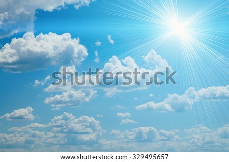 bright sun on blue sky clouds backround - stock photo