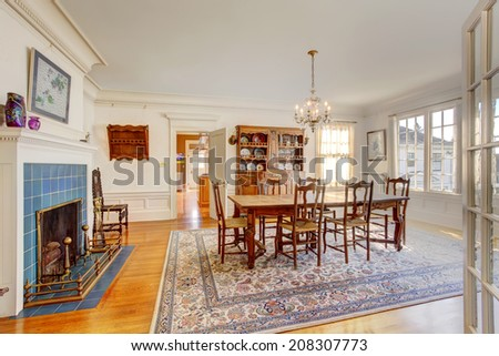 Bright sun room with french windows. Furnished with wicker table and chairs and glass top table - stock photo