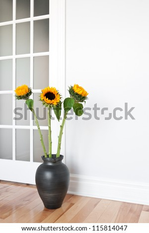 Bright sunflowers decorating a contemporary room. - stock photo