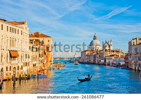 Bright sunny view of The Grand Canal with gondola the Santa Maria della Salute church, Venice, Italy - stock photo