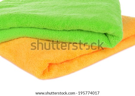 Bright towels isolated on white - stock photo