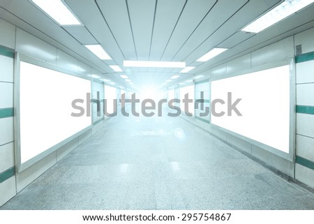 Bright underpass with blank billboard advertising wall for background. - stock photo