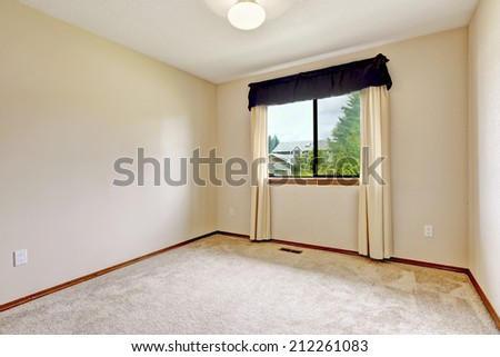 Bright white empty room with burgundy curtains and soft carpet floor - stock photo