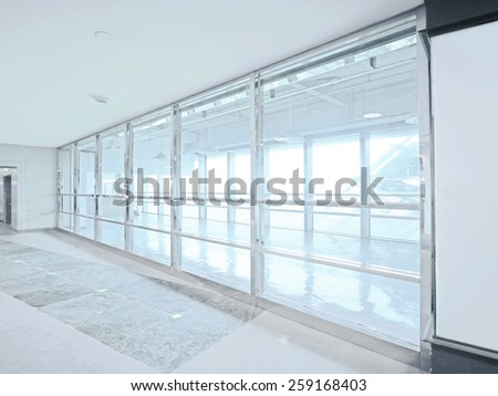 Bright window and walkway - stock photo