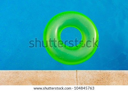 Bright yellow floater in the middle of the pool - stock photo