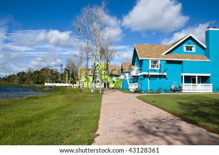 Brightly colored Abandon condominiums on a lake due to recession - stock photo