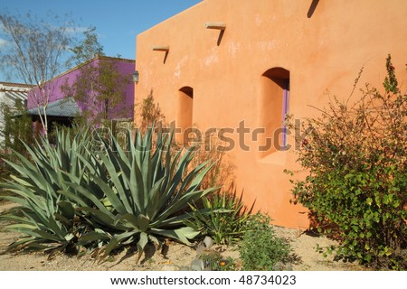 brightly colored adobe structures - stock photo