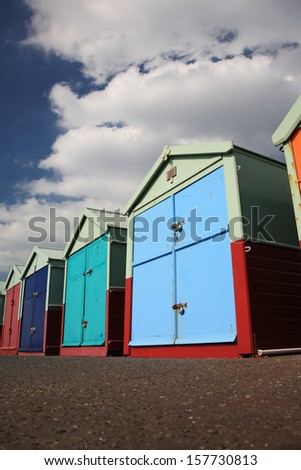 Brightly colored beach huts at Hove, Brighton - stock photo
