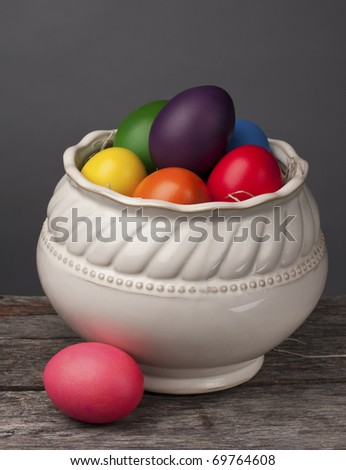 Brightly colored Easter Eggs on a grey background to make the colors pop. Beautiful and traditional decoration. - stock photo