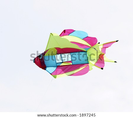 Brightly colored fish kite isolated against a white background. - stock photo
