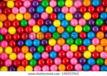 Brightly colored gum balls laying flat, background - stock photo