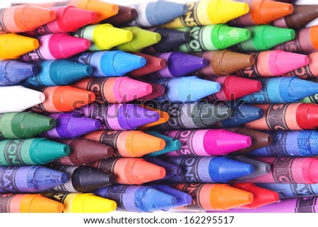 Brightly colored wax crayons on a white background - stock photo