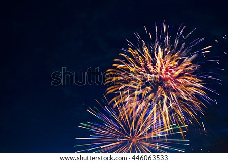 Brightly colorful fireworks and salute of various colors in the night sky. Independence Day, 4th of July, Fourth of July or New Year. - stock photo