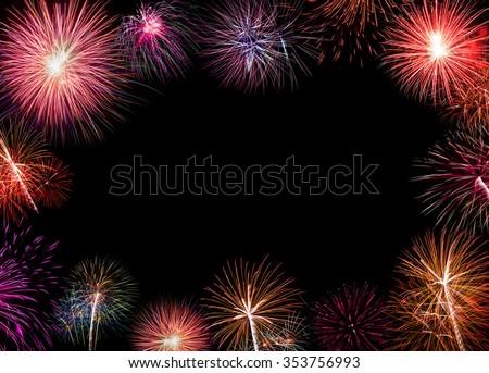 Brightly colorful fireworks background. New Year celebration fireworks. - stock photo