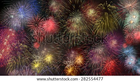 Brightly colorful fireworks in the night sky - stock photo