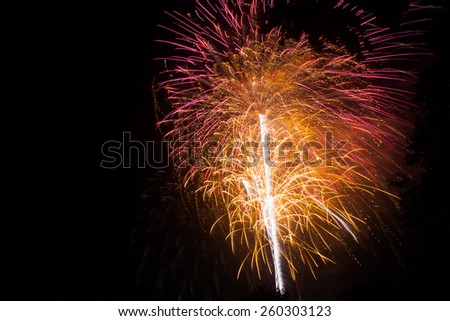 Brightly colorful fireworks in the night sky. New Year celebration fireworks. - stock photo