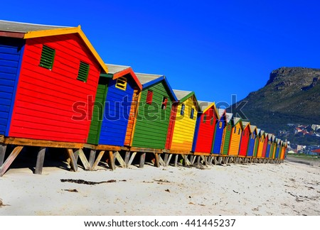 Brightly coloured Victorian beach houses - stock photo