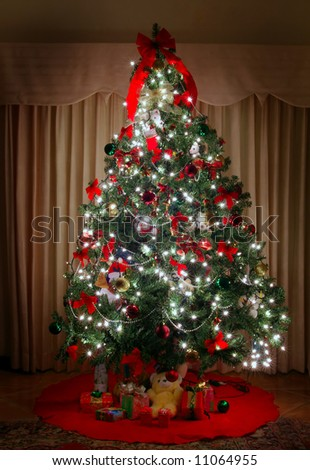 brightly lit christmas tree - stock photo