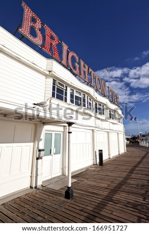 Brighton Pier sign with resident seagulls (UK) - stock photo