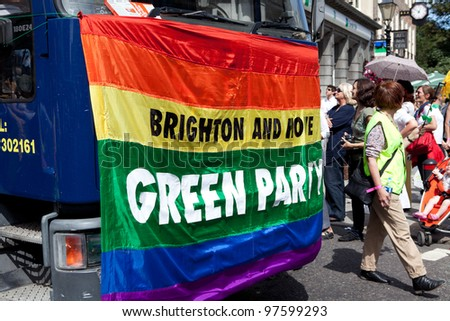 BRIGHTON, UK - AUG 13. Brighton and Hove Green Party take part in the Pride Parade at Brighton Pride Festival on August 13, 2011, Brighton, West Sussex, England. - stock photo