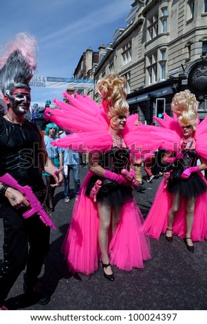 BRIGHTON, UK - AUG 13. Participants from the LGBT community dress in pink themed costumes in the pride parade at Brighton Pride Festival on August 13, 2011. - stock photo