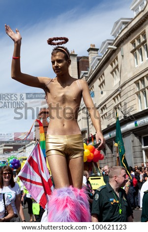 BRIGHTON, UK - AUG 13. The Golden Angel, a participant from the LGBT community join the pride parade at Brighton & Hove Pride Festival on August 13, 2011. - stock photo