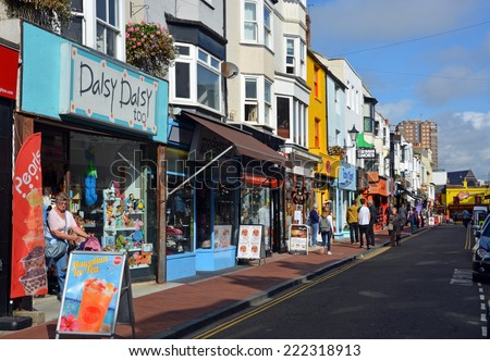 Brighton, United Kingdom - October 01, 2014: Tourists shopping in the famous North Laines district of Brighton, Surrey. - stock photo