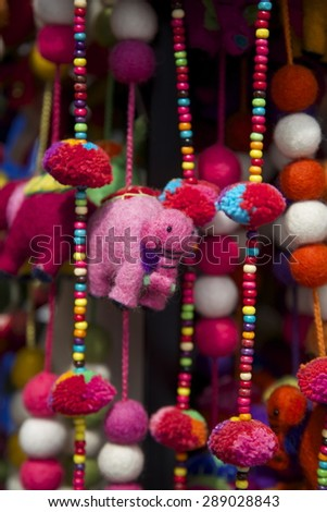 Brigth souvenirs at an outdoor street market in Singapore. - stock photo