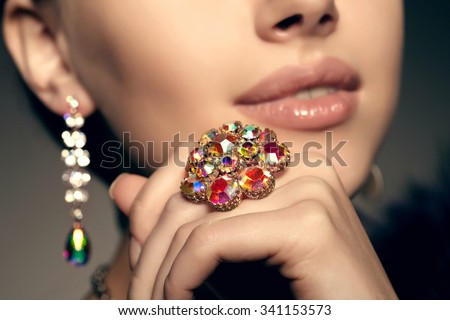 Brilliant. Antique old vintage earrings and ring. Jewelry on her finger at the girl close-up - stock photo