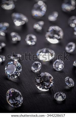 Brilliant diamonds on black background - stock photo