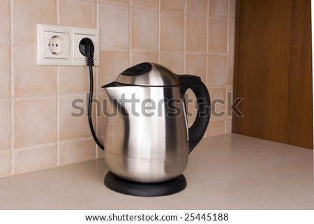 Brilliant kettle in the kitchen environment 2 - stock photo