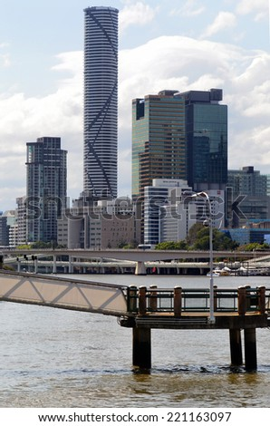 BRISBANE, AUS - SEP 24 2014: Infinity Tower skyline.Until the 1970s the City Hall's 100-foot (30-meter) tower was the most prominent building, but it was later dwarfed by numerous commercial high rises - stock photo
