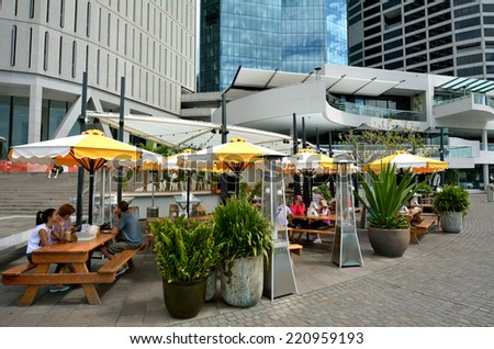 BRISBANE, AUS - SEP 25 2014: People dining in restaurant at Eagle Street Pier.It is an iconic waterfront precinct with world class dining options and unrivaled views of the Brisbane River.  - stock photo