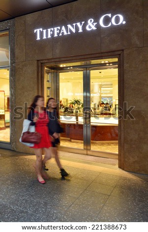 BRISBANE, AUS - SEP 25 2014:People passing by Tiffany & Co Store in Queens street mall.It is an American multinational luxury jewelry and specialty retailer founded at 1837. - stock photo