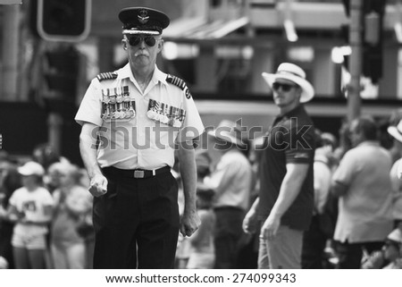 BRISBANE, AUSTRALIA - APRIL 25 : Airforce officer heavily adorned with medals marches  during Anzac day centenary commemorations April 25, 2015 in Brisbane, Australia - stock photo