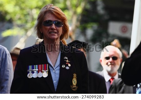 BRISBANE, AUSTRALIA - APRIL 25 : Female veteran marching during Anzac day centenary commemorations April 25, 2015 in Brisbane, Australia - stock photo