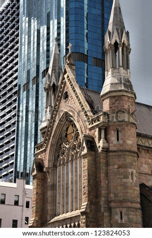 Brisbane, Australia. Cathedral of Saint Stephen shadowed by skyscrapers. - stock photo