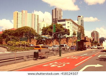 Brisbane, Australia - city street view with skyscrapers in background. Bus lane. Retro filtered colors. - stock photo