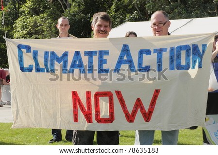 BRISBANE, AUSTRALIA - JUNE 6 : Men with climate action now sign at say Yes to carbon tax World Environment Day protest 6, 2011 in Brisbane, Australia - stock photo
