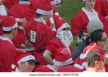BRISBANE, AUSTRALIA  NOV 27 :Group of unidentified santas gather pre Variety Santa Fun Run November 27, 2011 in Brisbane, Australia - stock photo