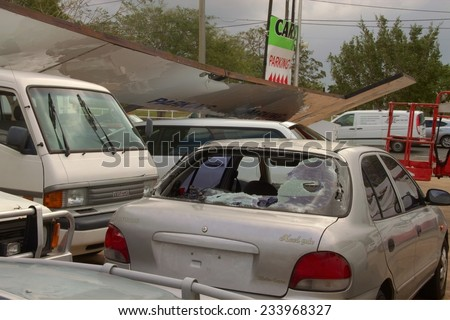 BRISBANE, AUSTRALIA - NOVEMBER 28 : Damage to car yard from super cell hail storm area declared disaster on November 28, 2014 in Brisbane, Australia - stock photo