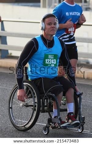 "BRISBANE, AUSTRALIA - SEPTEMBER 07 : Damon Jaenke  participating in the ""Bridge to Brisbane"" charity fun run on September 07, 2014 in Brisbane, Australia - stock photo"