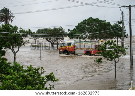 BRISBANE, QLD, AUSTRALIA - January 27: Queensland Fire Engine driving through a flooded street on 27 January 2013 in Brisbane - stock photo