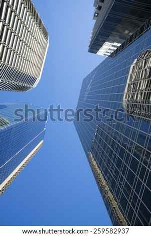 BRISBANE, QLD, AUSTRALIA - JULY 17, 2014: perspective view to steel and  glass high rise building skyscraper commercial modern city on riverside in Brisbane, QLD, Australia on July 17, 2014 - stock photo